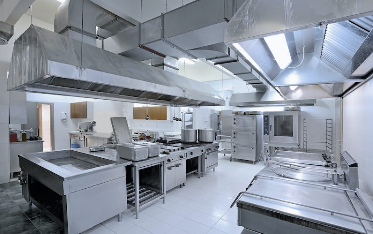 a picture of a commercial kitchen that has food grade PVC wall panels